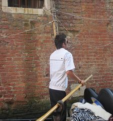 "womens tours.jpg alt=womens travel, back of gondalier with white shirt, venice"">"