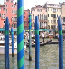 "womens tours.jpg alt=womens travel, blue and green boat poles, venice"">"
