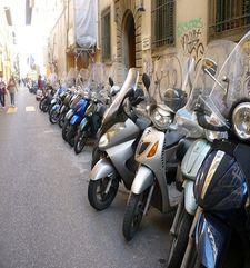 "womens tours.jpg alt=womens travel, line up of scooters, florence"">"