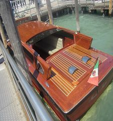 "womens tours.jpg alt=womens travel, rear view of wooden water taxi, venice"">"