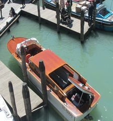 "womens tours.jpg alt=womens travel, looking diwn at water taxi tied to wharf, venice"">"