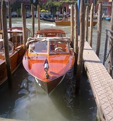 "womens tours.jpg alt=womens travel, front view of wooden water taxi, venice"">"