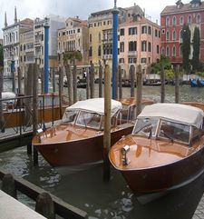 "womens tours.jpg alt=womens travel,two wooden water taxis, venice"">"