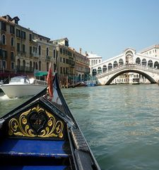 "womens tours.jpg alt=womens travel, gondola approaching the rialto bridge, venice"">"