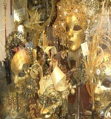 "womens tours.jpg alt=womens travel, masks in window, venice"">"