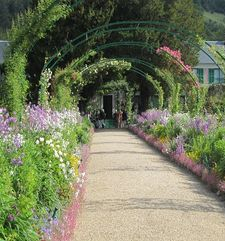 "ours.jpg alt=womens travel,  path in may, monets garden, giverny, france"">"