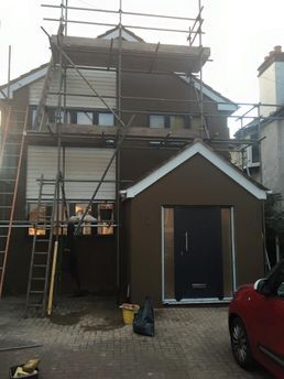 Sand and cement render front of house