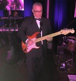 Michael Dones, guitar