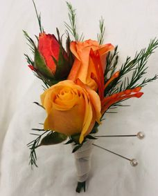 Orange Spray Rose Boutonniere with Pin Cushion Protea