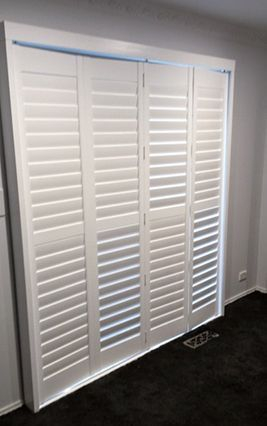 shutters in a bedroom modernize the room