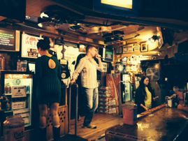 coporate pub crawl singing karaoke