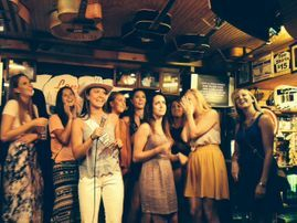 Sam and her bachleorette group sing on stage in Nashville