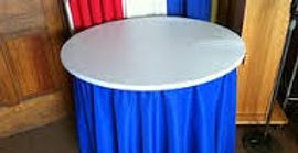 Plastic Elastic Table cover over linen