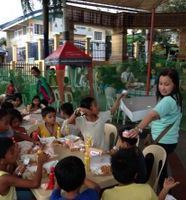 Street children with Jolibee