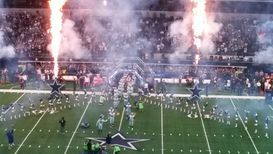 Dallas Cowboys enter field before game.