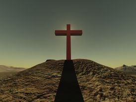 Cross on a hill top in the desert.