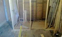 Stud work created and boarded to produce room.