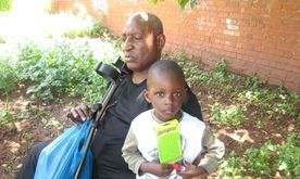 Children and his father receiving their food parcels