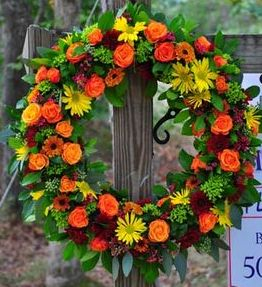 Sympathy wreath of rich fall colors.