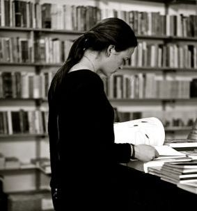 A lady reading/proofing a manuscript/book
