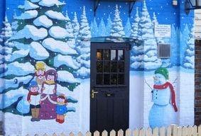 pub mural hand painted Christmas snow trees snowman carol singers