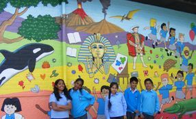 youth school mural hand painted community group project whale trees