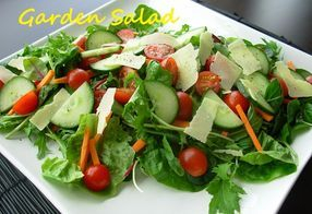 Garden Greens Salad loaded with  cucumbers, carrots, tomatoes and carrots