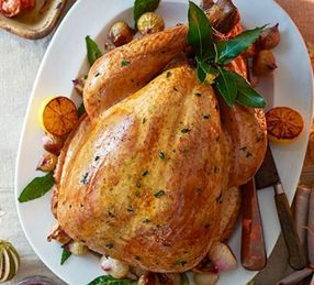 Golden roasted baked turkey with trimmings