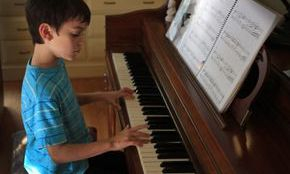 Edward loves piano lessons