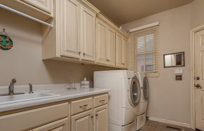 Fresh coat a paint on the walls and new cabinets in the laundry might make you want to do some