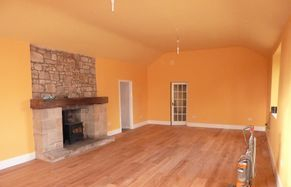 large family room painted orange. seems like a different colour but should help bring up the energy level