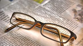 Newspaper under glasses