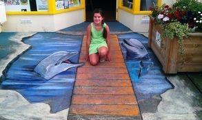 anamorphic street art chalk mural dolphins sea water bridge drawn
