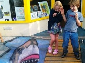 chalk art anamorphic street bridge herne bay shark ocean water teeth