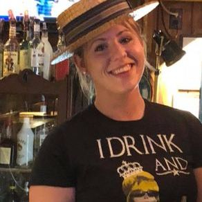 Amanda bartending with favorite hat