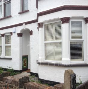 Another project in Essex, this time a bay window dressed with our wooden shutters.