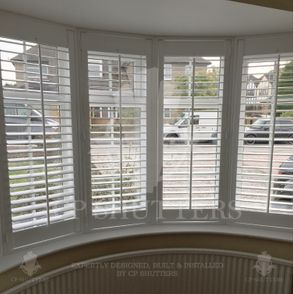 This is a curved bay window, dressed with our bespoke interior wooden window shutters, shenfield, essex