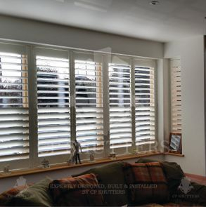 These bespoke interior wooden shutters were custom made for this window in Essex by CP Shutters