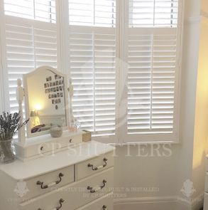 White wooden shutters fitted in a bedroom, leigh on sea, Essex, by CP Shutters