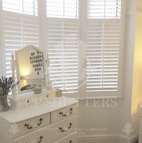 This image shows a close up our bespoke interior shutters fitted in an Essex bedroom.