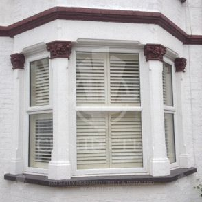 Our interior wooden shutters, installed in a bay window, Essex