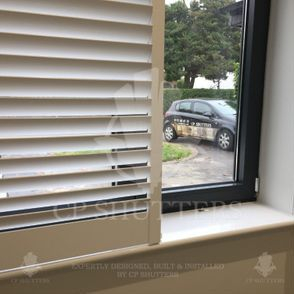 The CP Shutters car seen through our bespoke wooden window shutters