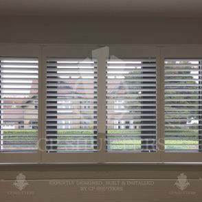 Window shutter made of wood, fitted in this home by CP Shutters, Essex