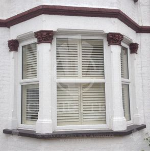 Interior wooden plantation shutters, installed in a bay window by CP Shutters