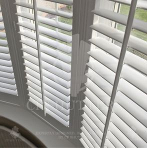 White wood shutters, installed in Essex by CP Shutters