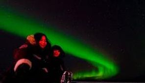Winter aurora hunting in Yellowknife ice road