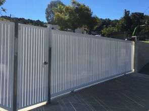 Vertical slatted aluminium fencing and gates