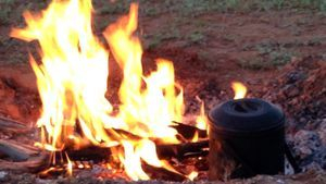 Campfire cooking on Beltana Station Flinders Ranges with Outback Australian Camels Treks and Safaris