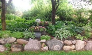 Boulder Wall built by Landscape Designs Inc.