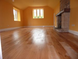 QMI can make a wood floor look shiny and new.